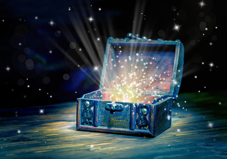 close up concept greeting card of opened vintage chest treasure